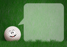 Funny golf ball in the green Royalty Free Stock Photos