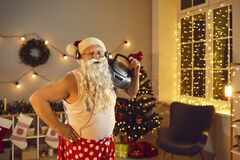 Free Funny Granddad With Santa Beard, Headphones And Boombox Having Fun On Christmas Night At Home Stock Photo - 202502910