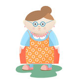 Funny grandmother with glasses with pearl beads and earrings in a flowered apron. Stock Images