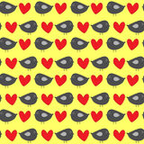 Funny gray birdies with red hearts on a yellow background. Colorful seamless pattern for children. Royalty Free Stock Photography