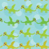 Funny green dragon with wings on blue background Royalty Free Stock Image