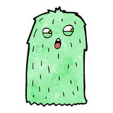 Funny green hairy monster cartoon Stock Image