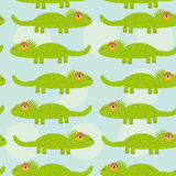 Funny green iguana Seamless pattern with cute animal on a blue b Stock Images