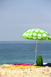 Funny green sun ubrella on the beach Royalty Free Stock Photo