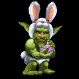 Funny green Troll in Bunny suit with ball stock illustration