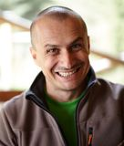 Funny grin. Closeup of a caucasian man outdoor with a funny grin Stock Image