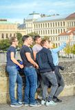 Funny group of guys tourists taking selfie on Charles bridge, Prague, Czech Republic royalty free stock photography