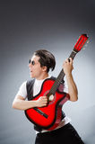 Funny guitar player in musical concept Royalty Free Stock Image