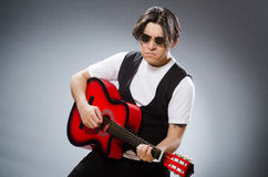 Funny guitar player in musical concept Stock Photos