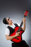 Funny guitar player in musical concept Stock Images