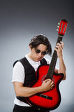 The funny guitar player in musical concept Royalty Free Stock Photo