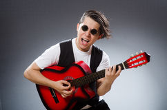 The funny guitar player in musical concept Royalty Free Stock Photography
