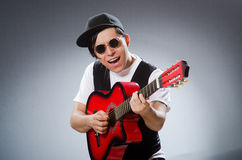 The funny guitar player in musical concept Royalty Free Stock Image