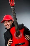 Funny guitar player Stock Photography