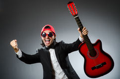 Funny guitar player Stock Image