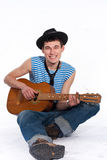 Funny guitarist. In white studio Royalty Free Stock Images