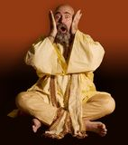 Funny Guru. Sitting lotus style with a surprised expression Royalty Free Stock Photo