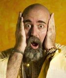 Funny Guru. Funny bald guru with a long beaded beard Royalty Free Stock Photos