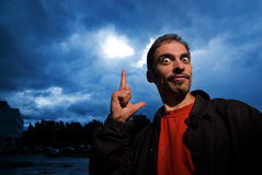 Funny guy. Over dark cloudy sky before rain stock image