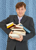 Funny guy with an armful of textbooks Royalty Free Stock Image