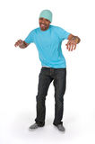 Funny guy in a blue t-shirt dancing. Isolated on white background Royalty Free Stock Photos