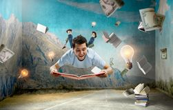 Reading as self education. Mixed media. Funny guy with book in hands levitating in air. Mixed media royalty free illustration