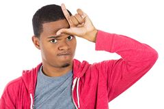 Funny guy displaying loser sign Stock Photo