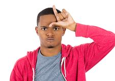 Funny guy displaying loser sign Stock Image