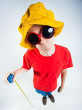 Funny guy dressed crazy holding a measuring tape Royalty Free Stock Images
