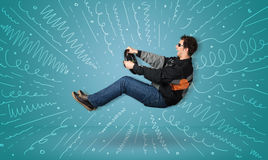 Funny guy drives an imaginary vehicle with drawn lines around hi Stock Photos