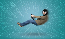 Funny guy drives an imaginary vehicle with drawn lines around hi Royalty Free Stock Images