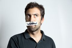 Funny guy with fake moustache Royalty Free Stock Photo