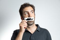 Funny guy with fake moustache Stock Image