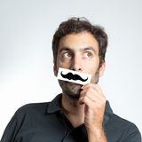 Funny guy with fake moustache Royalty Free Stock Images