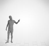 Funny guy in morphsuit body suit looking at copy space Royalty Free Stock Photography