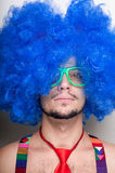 Funny guy naked with blue wig and red tie Royalty Free Stock Image