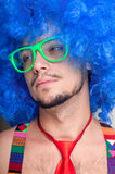 Funny guy naked with blue wig and red tie Royalty Free Stock Photo