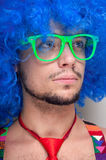 Funny guy naked with blue wig and red tie Royalty Free Stock Photography