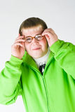 Funny guy with old glasses. Young man in a green shirt with old glasses Royalty Free Stock Photo