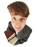 Funny guy with pile of books Royalty Free Stock Photography