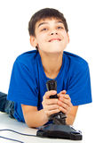 Funny guy plays with a joystick Stock Photos