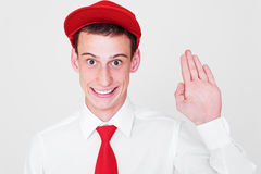 Funny guy in red cap. Portrait of funny guy in red cap over grey background Stock Photo