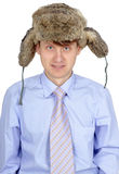 Funny guy in russian earflaps and tie Royalty Free Stock Image