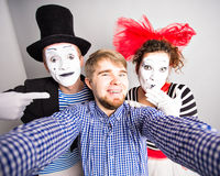 Funny guy selfie with mimes, april fools day concept Royalty Free Stock Image