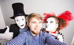 Funny guy selfie with mimes, april fools day concept Stock Images