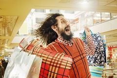 Funny guy on a shopping trip Royalty Free Stock Images