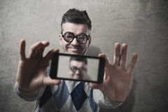 Funny guy taking a selfie Stock Photo
