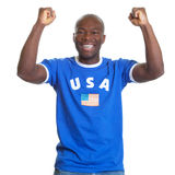 Funny guy from USA. Funny sports fan from USA in the jersey of the national team cheering at camera on an isolated white background for cutout Stock Photos