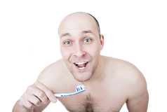 Funny guy washing teeth royalty free stock images
