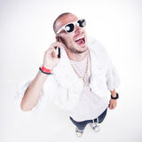 Funny guy wearing fur and hipster glasses while laughing hard Stock Photography